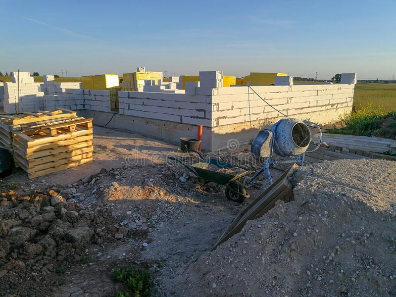 First stages of building a house. Half build first floor. First stages of building a house. Half build from silicate blocks royalty free stock image