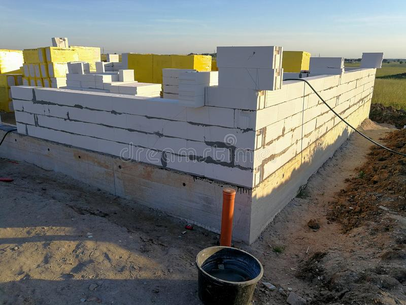 First stages of building a house. Half build first floor. First stages of building a house. Half build from silicate blocks stock photography