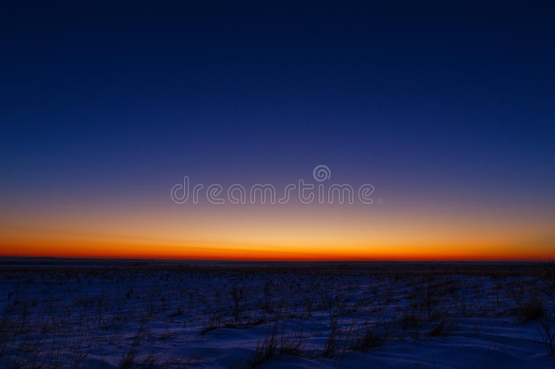 First stars in the background of a bright sunset. The first stars in the background of a bright sunset royalty free stock photography