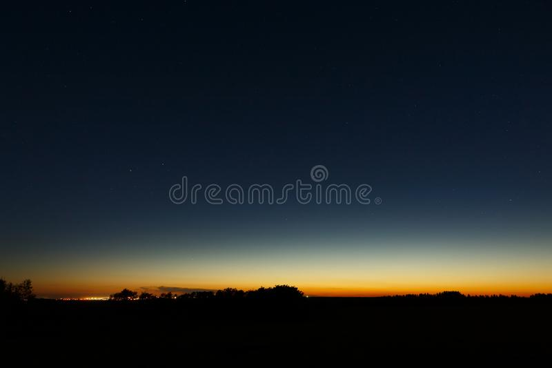 The first stars in the twilight sky at sunset.  royalty free stock photo