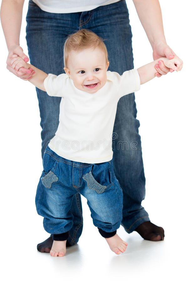 Download First Steps Of Baby Boy With Help Of Mothers Hands Stock Image - Image: 28859231