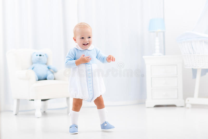 First steps of baby boy learning to walk royalty free stock images