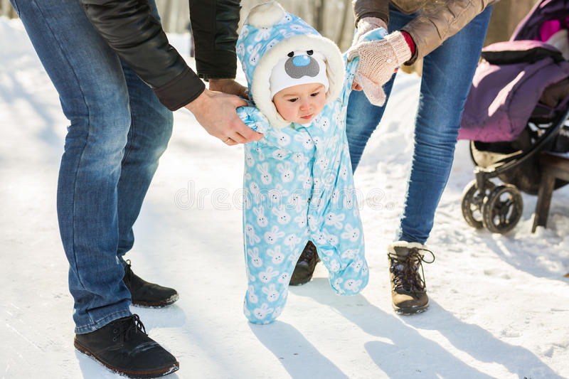 First steps of a baby in winter park stock photography