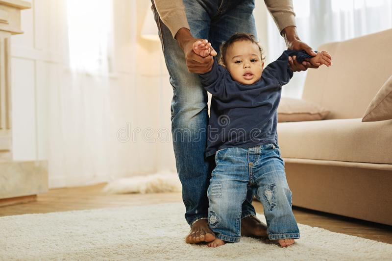 Sweet child learning to walk royalty free stock photo