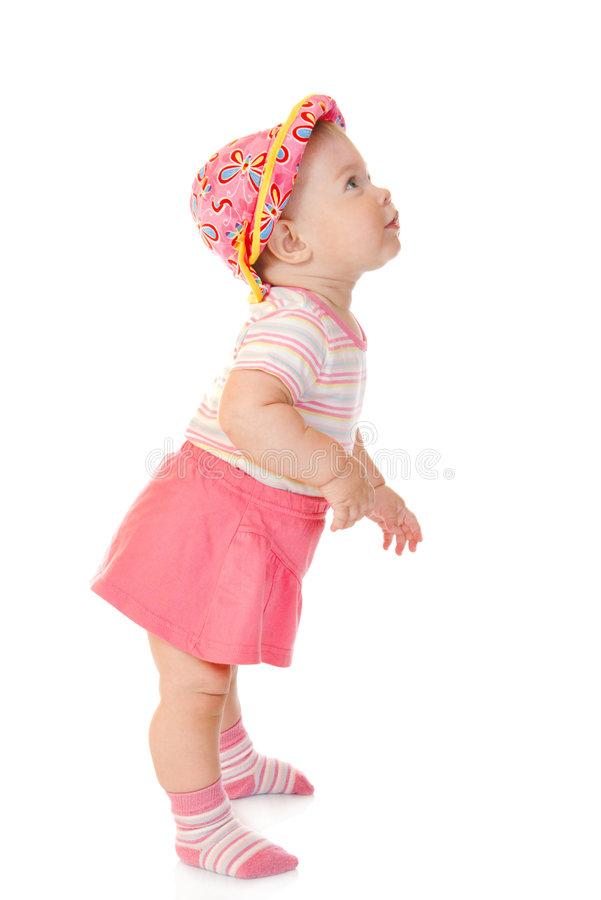 First steps of small baby in red dress stock images