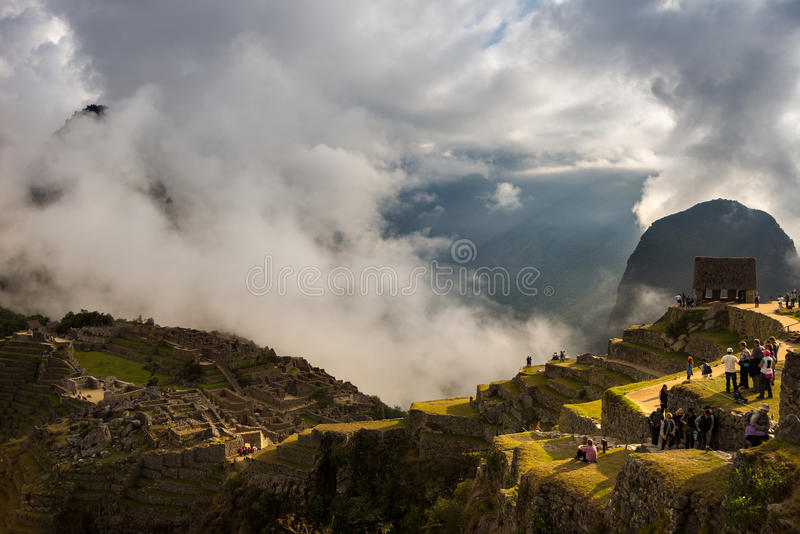 First sunlight on Machu Picchu from opening clouds royalty free stock photos