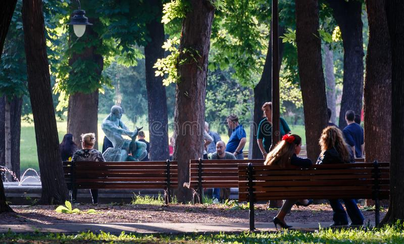 Belgrade, Serbia, June 2, 2019 : Sunny day in the Belgrade park, young people enjoying nice weather near the fountain stock photo