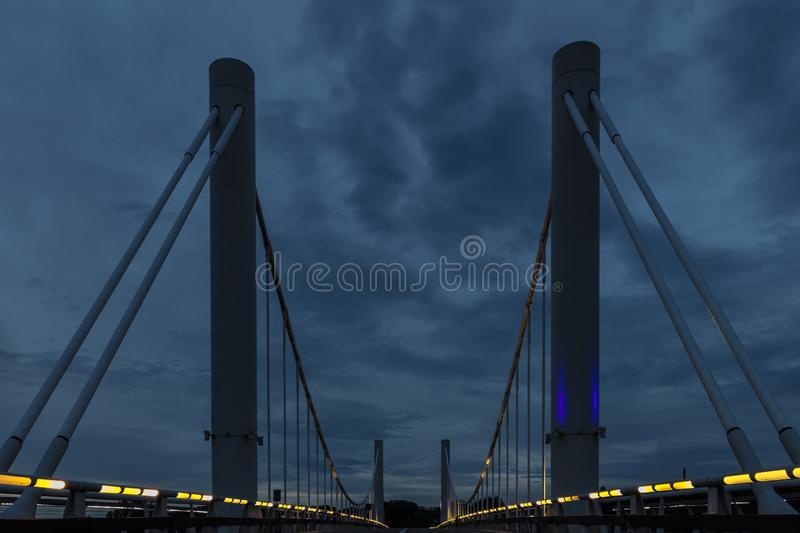 The first suspension bridge in Belgium located in Kanne. With a span of 120 against a dramatic evening sky during twilight royalty free stock photo