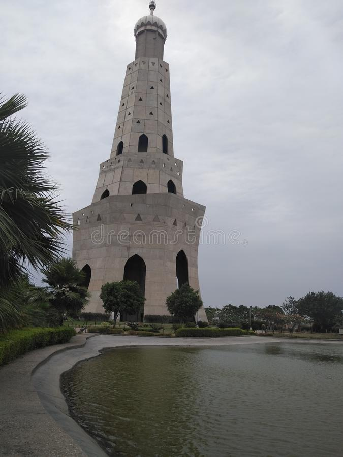 First Tallest minar in India - Fateh burj, Punjab. Renovated unique structure of Fateh burj with the well developed peaceful green cover, fresh water body and stock images