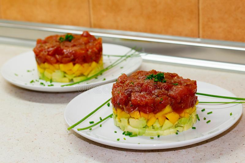 First tartar of tuna, avocado and mango made by me in July 2018 in Toledo stock image