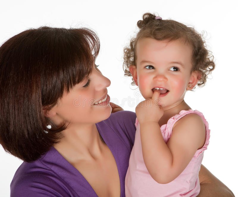 First teeth. Mother and little toddler girl feeling her first teeth royalty free stock images