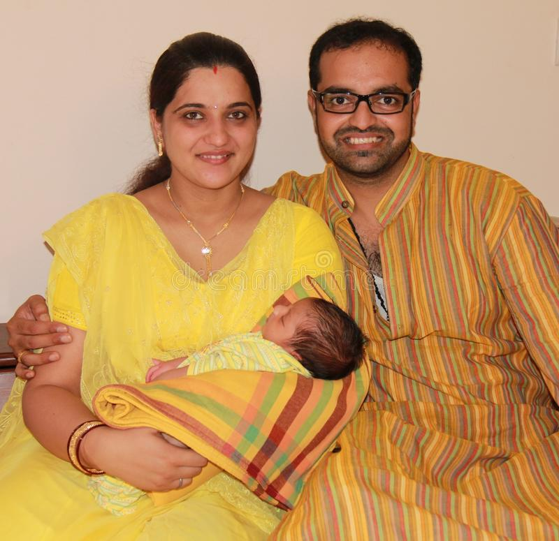 First time Indian (Asian) parent with their baby stock image