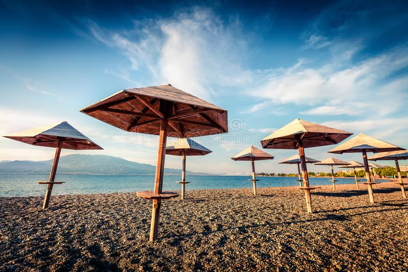 First warm days on the Nafpaktos beach. Sunny spring seascape of Corinth Gulf. Splendid morning scene of Greece resort. Vacation. Concept background royalty free stock images