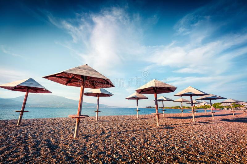 First warm days on the Nafpaktos beach. Sunny spring seascape of Corinth Gulf. Splendid morning scene of Greece resort. Vacation. Concept background royalty free stock photos