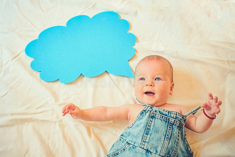 First word. Family. Child care. Childrens day. Sweet little baby. New life and birth. Portrait of happy little child. Small girl. I can speak. Word in cloud royalty free stock images