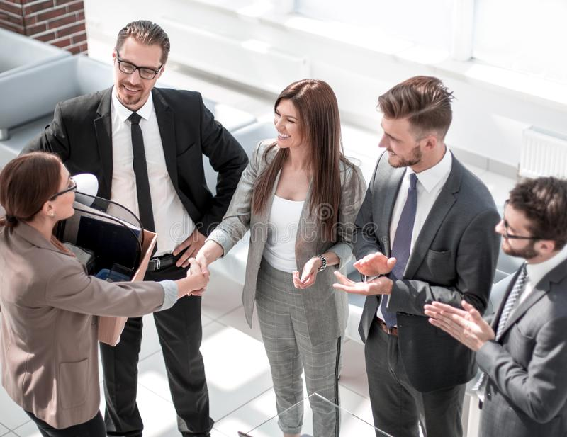 First working day.business woman shaking hands with new employee stock image