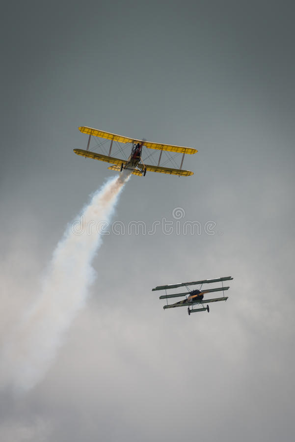 First World War dogfight. Cosford, UK - 08 June 2014: World War 1 vintage dogfighting aircraft seen at RAF Cosford Airshow royalty free stock photos