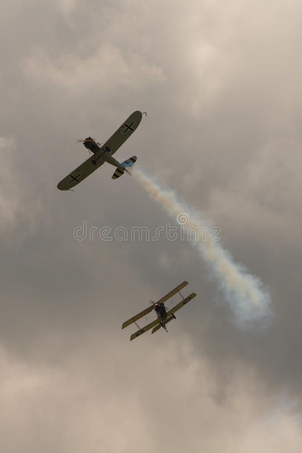 First World War dogfight. Cosford, UK - 08 June 2014: World War 1 vintage dogfighting aircraft seen at RAF Cosford Airshow royalty free stock image