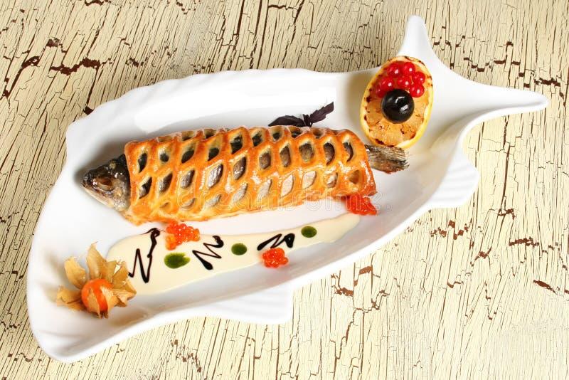 Fische mit Brot lizenzfreie stockbilder