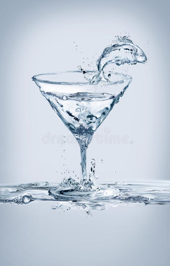 Fische und Martini-Glas stockfotos