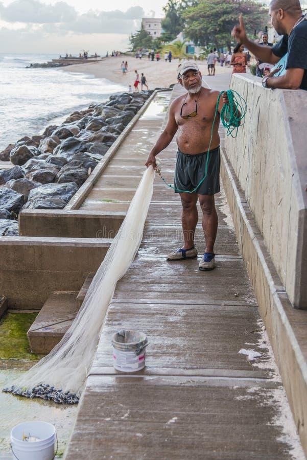 Fischer mit Netto-Barbados stockfotografie
