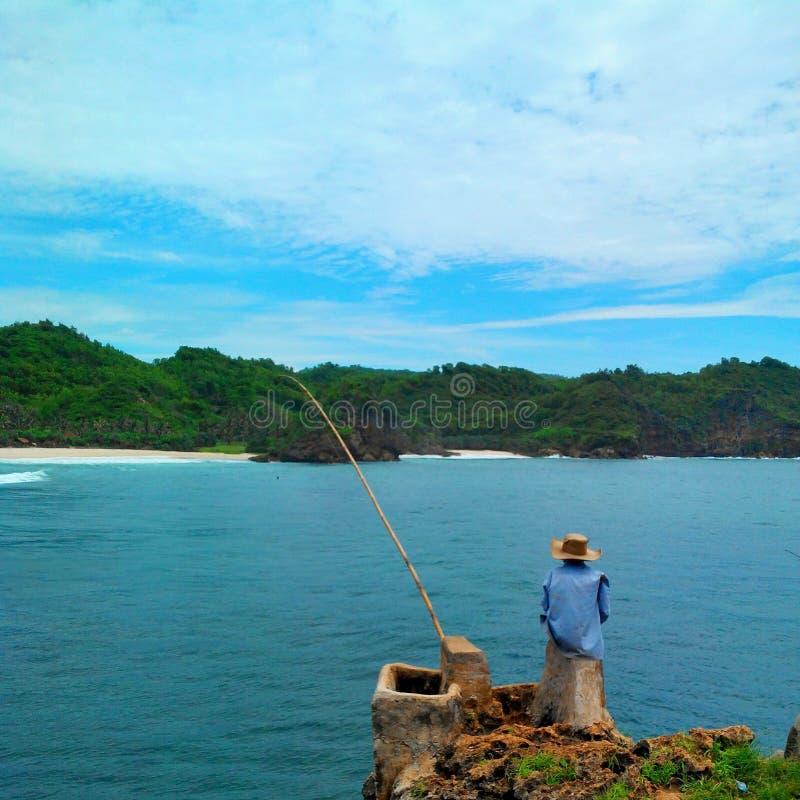 Fischer und Angelrute lizenzfreie stockbilder