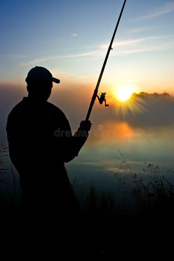 Fischerei im frühen Morgen stockfoto