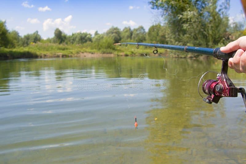 Fischerei mit Stange lizenzfreie stockfotografie