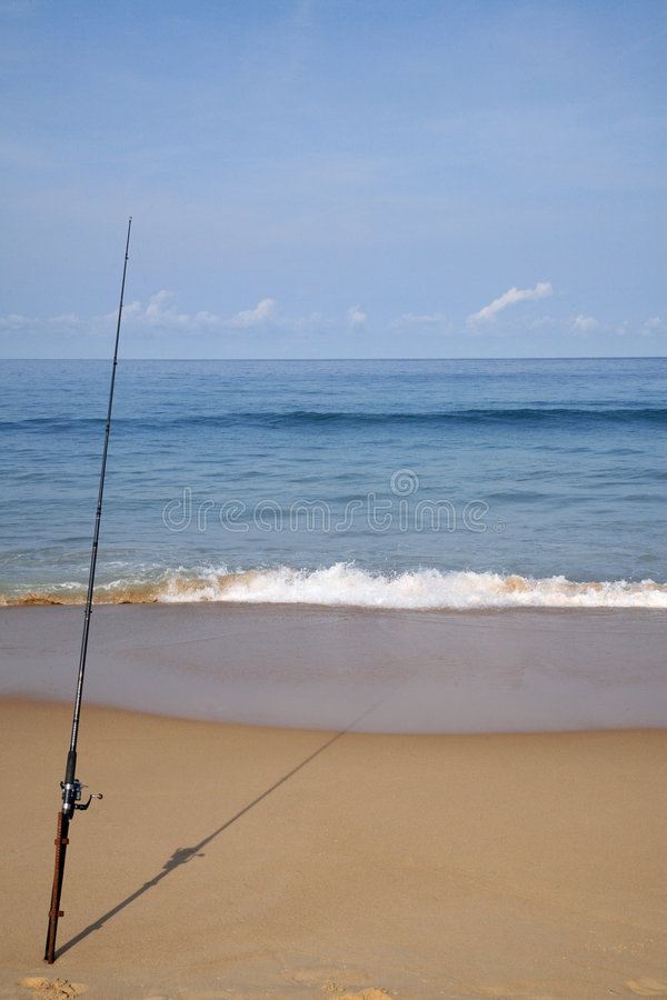Fischerei am Strand lizenzfreies stockbild