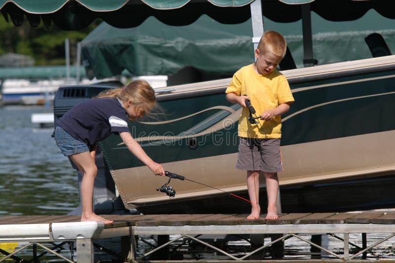 Fischerei weg von einem Dock stockbild