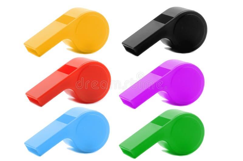 Fischio di plastica colorato fotografie stock