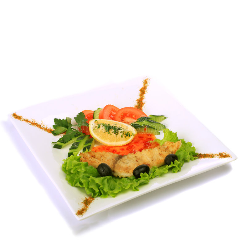 Fish. Gourmet grilled fish on rectangular plate stock photo