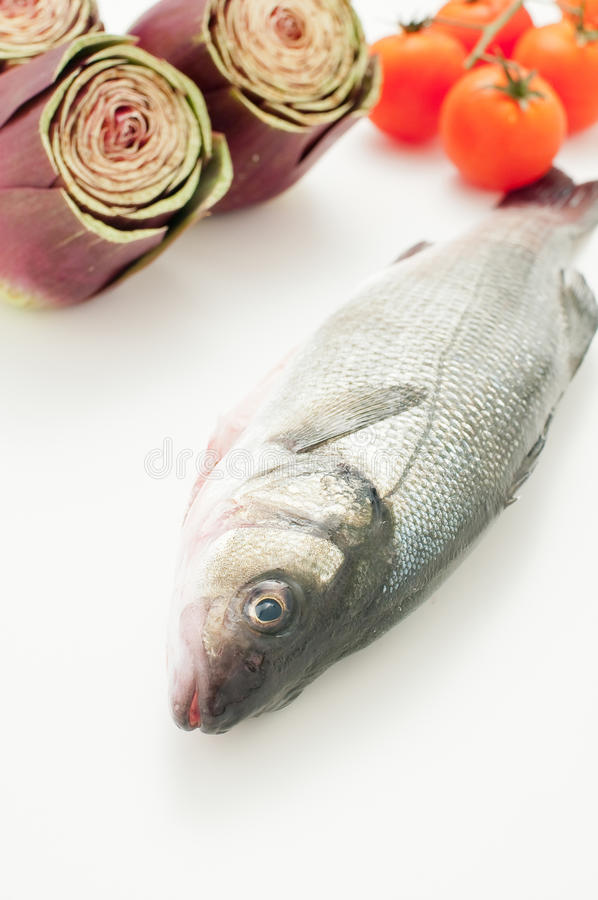 Fish already cleaned sea bass ready to be cooked royalty free stock photo