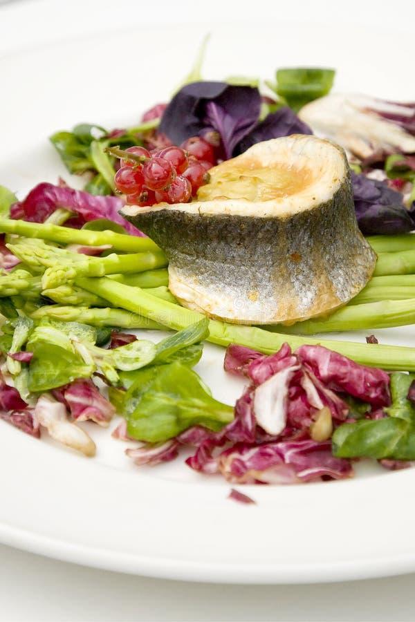 Fish and asparagus stock photos