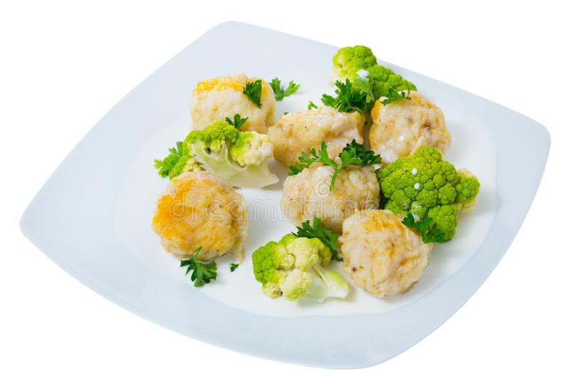 Fish balls of different white fish at plate with broccoli, dish of Norwegian cuisine. Fiskeboller. Isolated over white background royalty free stock images