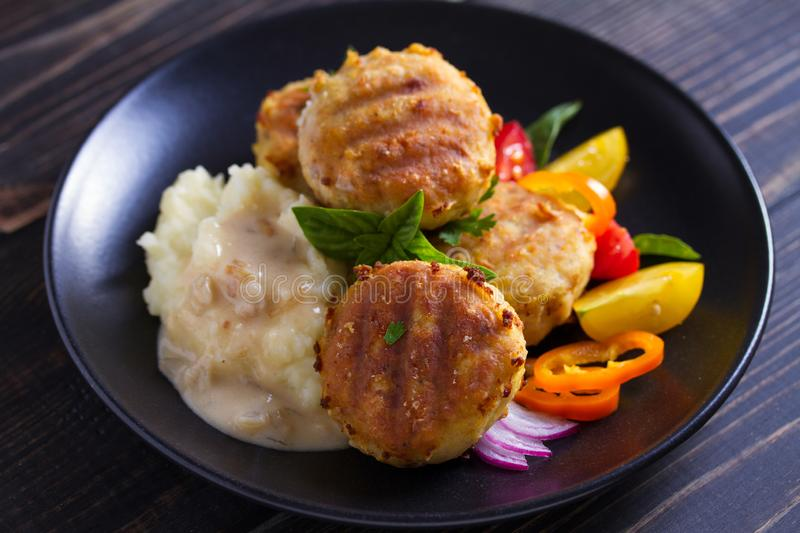 Fish cakes with mashed potatoes and vegetables. Fish patties. Fried cutlets of minced fish. Fish cakes with mashed potatoes and vegetables. Fish patties. Fried stock images