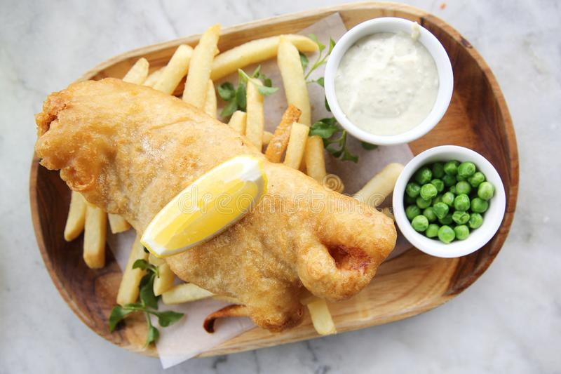 Fish and chips. With french fries royalty free stock photography