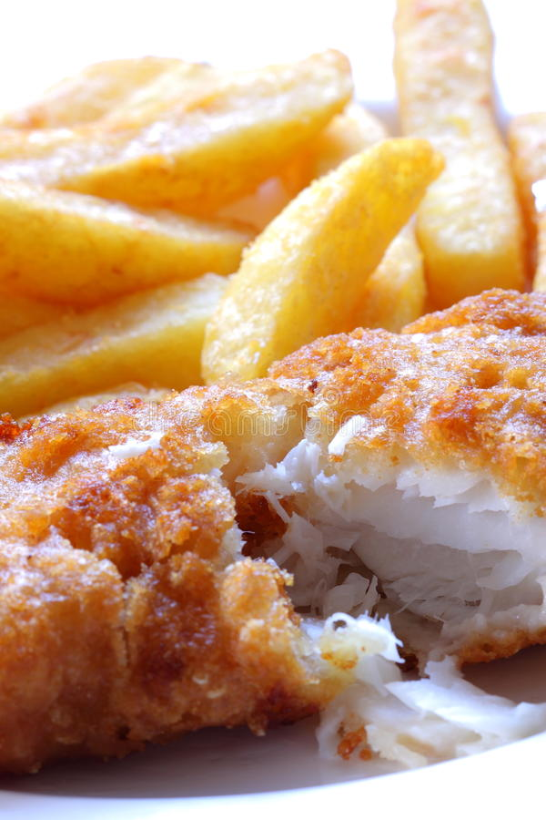 Fish and chips. Photograph of battered haddock and chips on a plate royalty free stock photography
