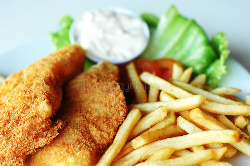 Fish and chips. Served with cream and vegetables