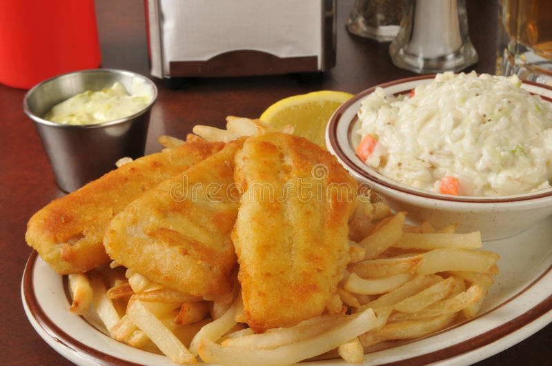 Fish and chips with coleslaw. Beer battered fish sticks with french fries and coleslaw stock photography