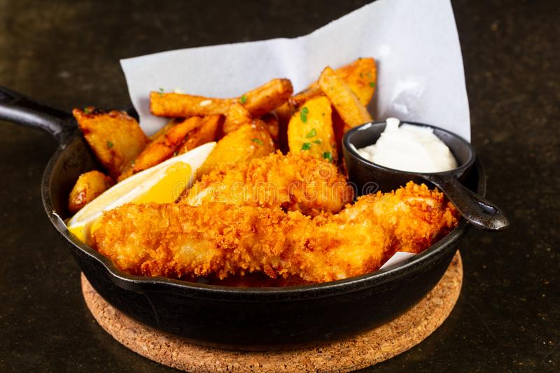 Fish and chips. In the pan royalty free stock image