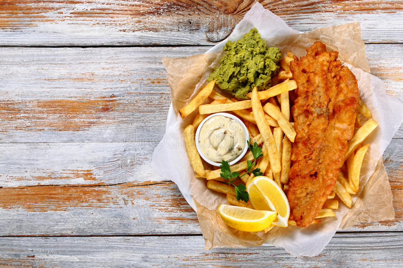 Fish and chips - fried cod, french fries stock image