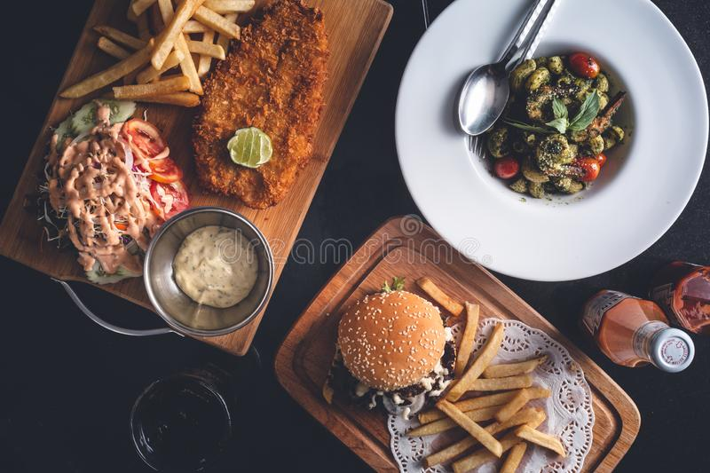 Fish and Chips, Fries and Burger, Pasta Dish on Restaurant Table. Restaurant menu Set stock photo