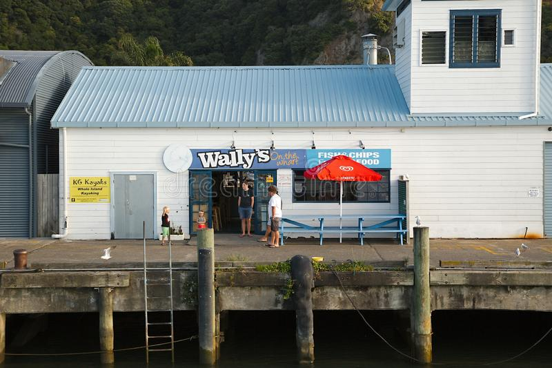 Fish And Chips Restaurant in New Zealand. WHAKATANE, NEW ZEALAND - MARCH 4, 2016: Small seafood restaurant on the pier in the harbor offering fish and chips and royalty free stock images
