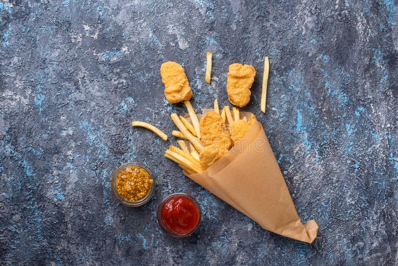 Fish and chips with tomato sauce and mustard stock images