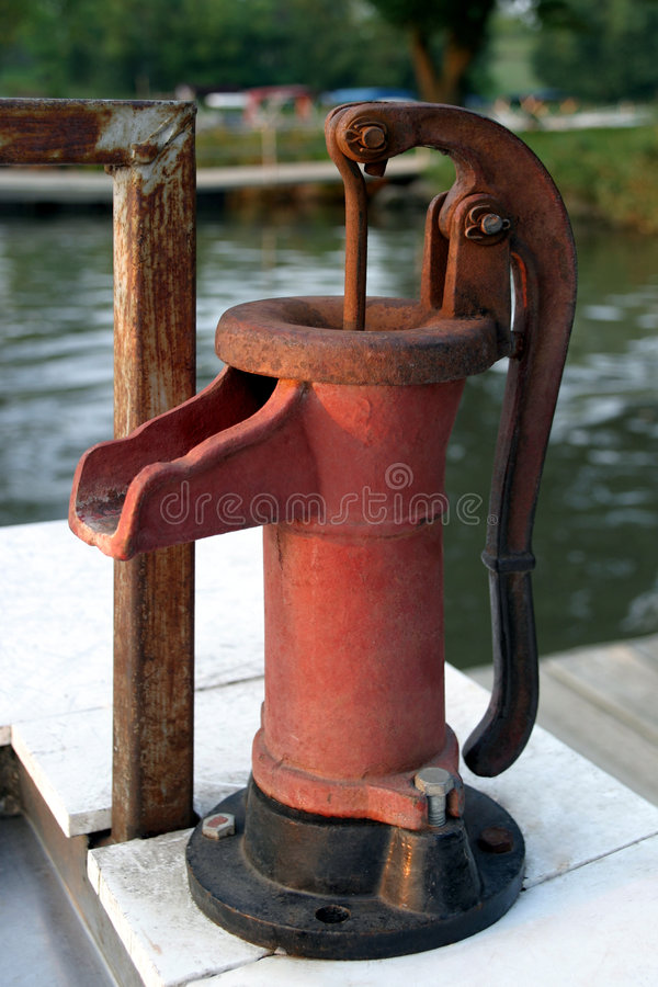 Free Fish Cleaning Pump - Red Stock Photo - 1270190