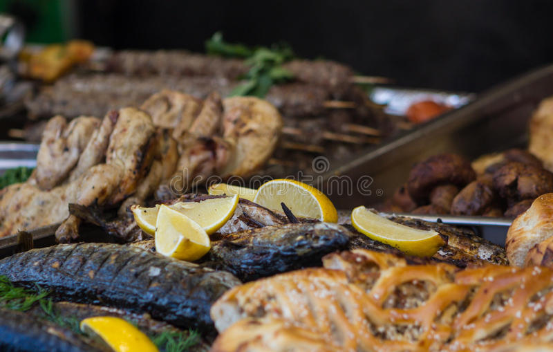 Fish cooked with lemon. Cooked fried fish with lemon on the table food photo on plate in restaurant royalty free stock photo
