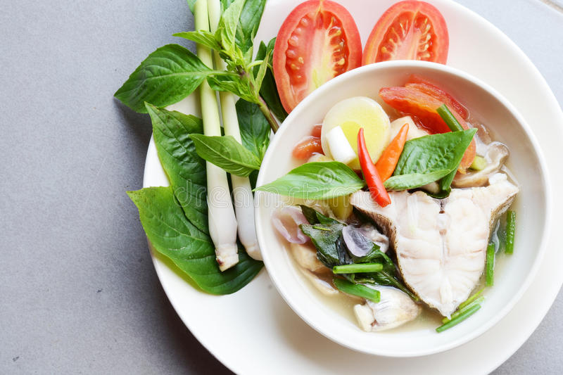 Fish for cooking recipe. Sea fish cooking in clear soup recipe stock image