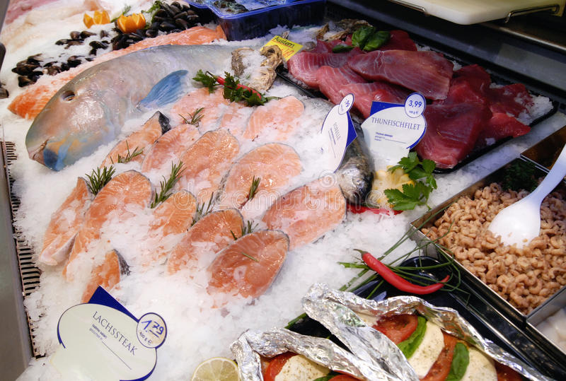 Fish counter in a grocery store. Detail of a fish counter in a grocery store royalty free stock photo