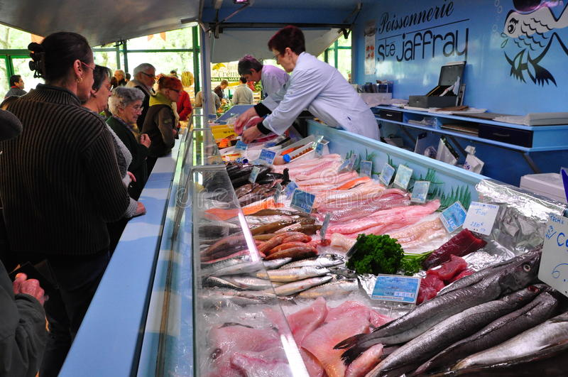 Fish Counter at Weekend Market in France. People line up to purchase fresh seafood at a regular weekend market in the village of La Gacilly in the Brittany royalty free stock photography